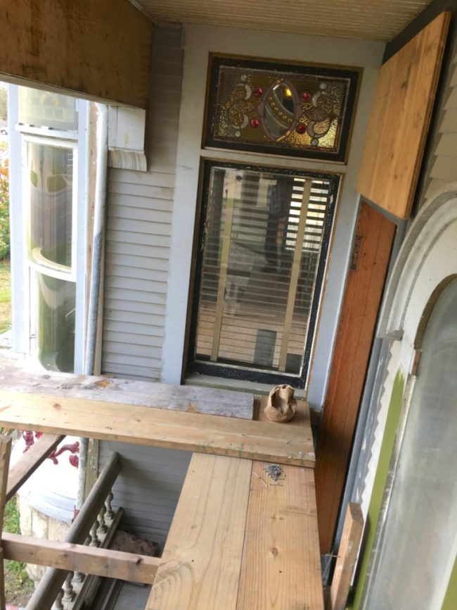 We are on scaffolding about four feet above the north porch floor. This has made it effortless to reach the porch ceiling and surrounding walls. And I am almost done! Oh, and see the upper left corner of the siding?