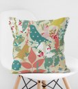 Retro floral bird pillow on chair