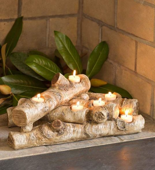 No working fireplace? No problem! Create your own with these logs and tea lights
