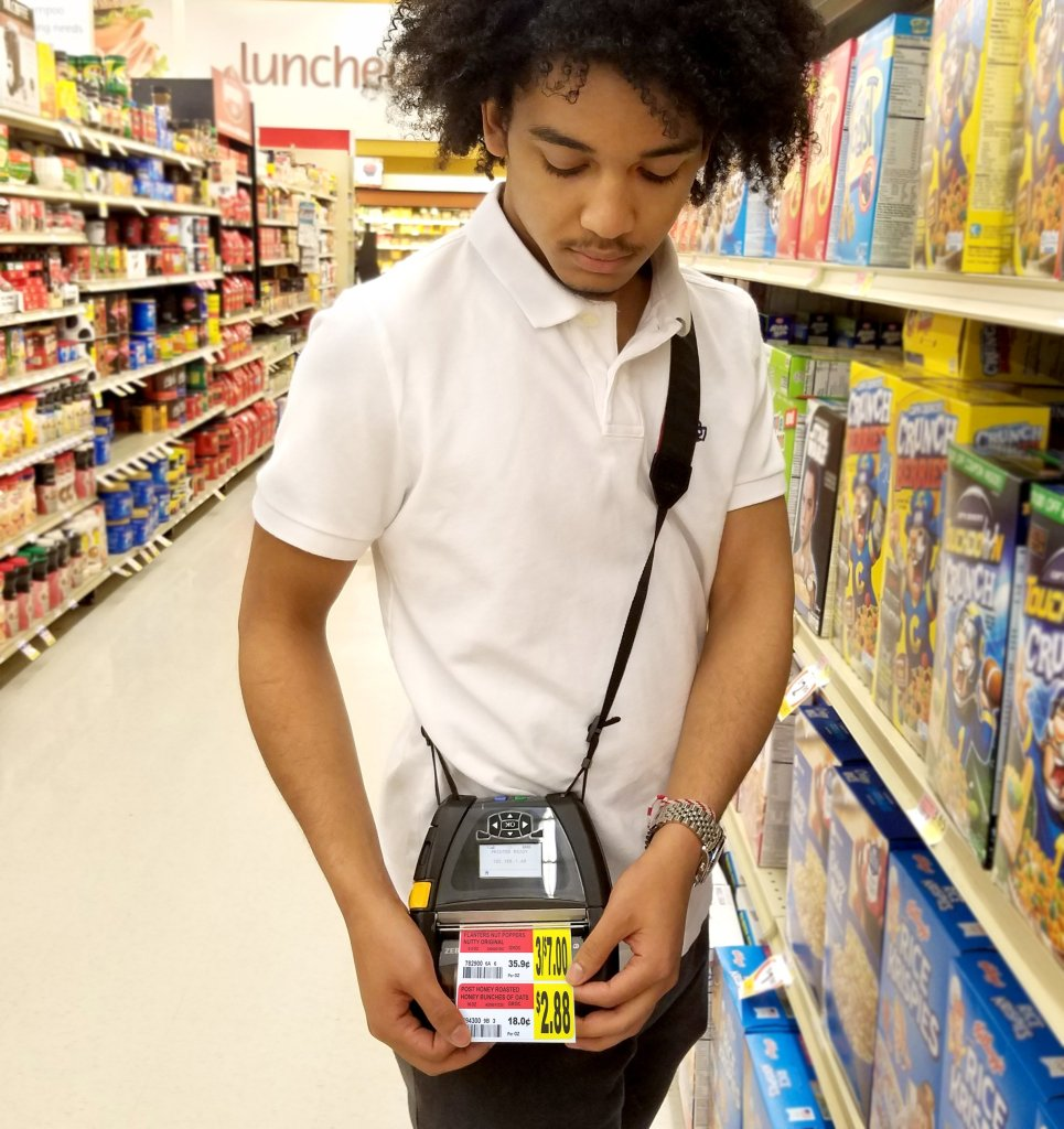 Grocery store employee using N-Aisle Printing by RTI