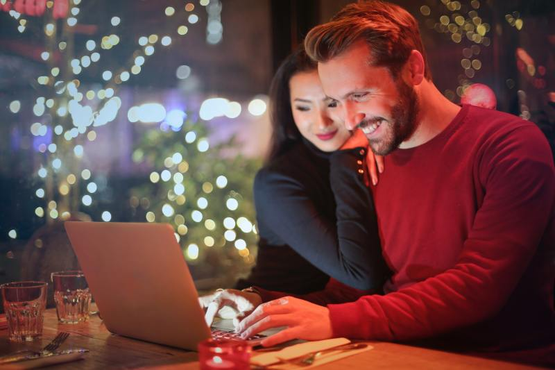 Couple shopping online during the holidays