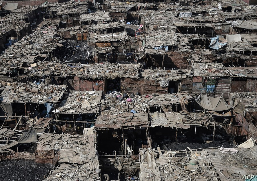 FILE - A general view of Ezbet al-Nakhl, a shanty town north of the Egyptian capital Cairo, is seen Oct. 13, 2018.