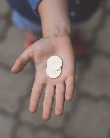Money in child`s hand