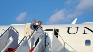 John Kerry boarding a plane for Switzerland for the bug meetings in Geneva and Davos.