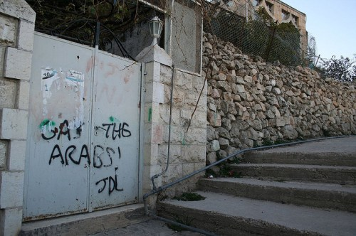 Jewish graffiti on a Palestinian home