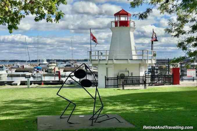 Waterfront Confederation Park Sculptures Flora MacDonald lighthouse - Along Lake Ontario To Kingston Ontario.jpg