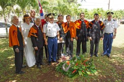 Royal order of Kamehameha I, Hawaii Chapter members and Hawaii Army National Guard officers pose at the gravesite of American Civil War veteran J.R. Kealoha. Standing in the back with the flag are retired HIARNG Soldiers Master Sgt. Haines Rego and State Command Sgt. Maj. James Kahalehoe. Col. Moses Kaoiwi Jr., 29th Infantry Brigade commander and director of Joint Staff, and Col. Stephen F. Logan, HIARNG chief of staff, represent currently serving Soldiers.