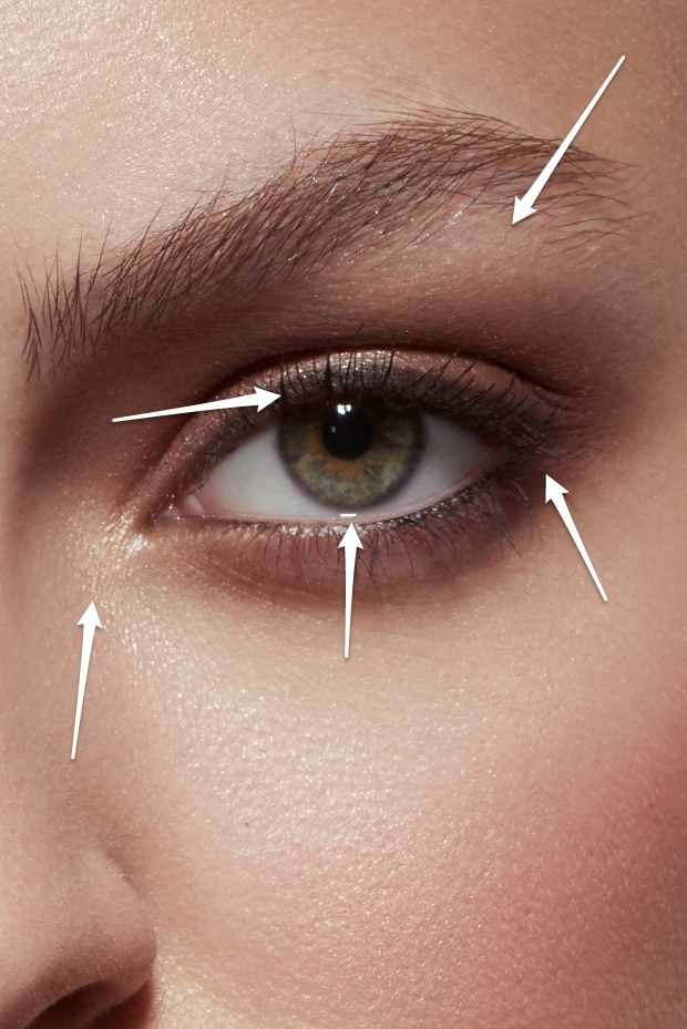 Highlighter in the corner of the eye and under the eyebrow, defined upper lashline, nude lower waterline and darkened outer corner.