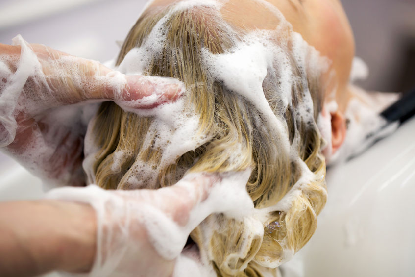 39657939 - hairdresser washing hair for a blonde girl in hair studio