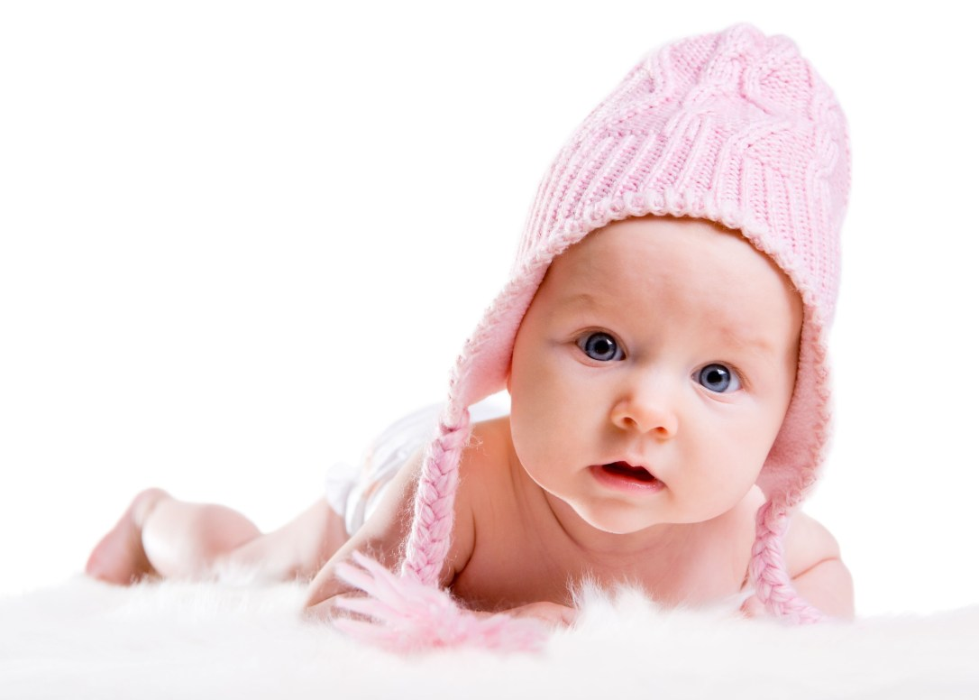 3693949 - portrait of three months old baby girl wearing pink winter hat