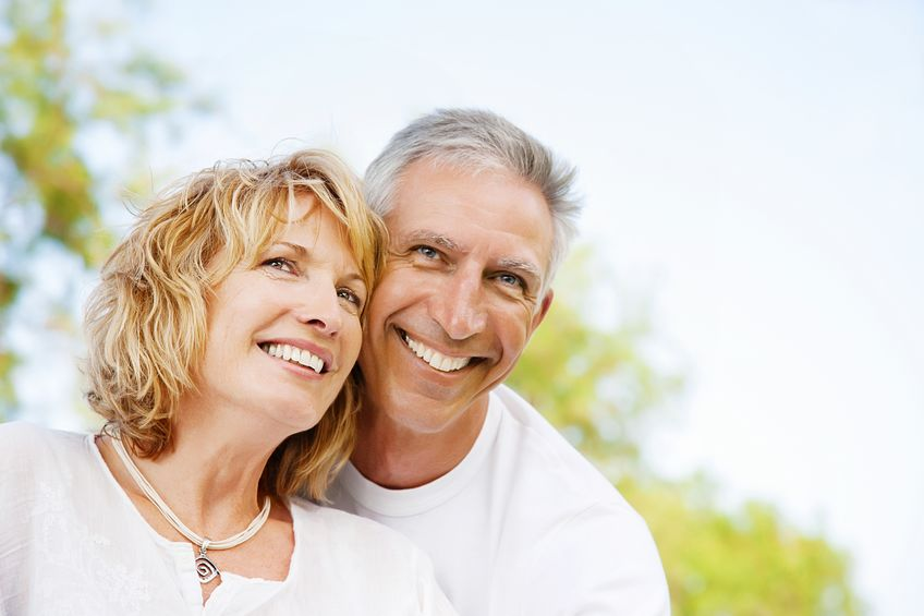 12668907 - portrait of a happy mature couple outdoors