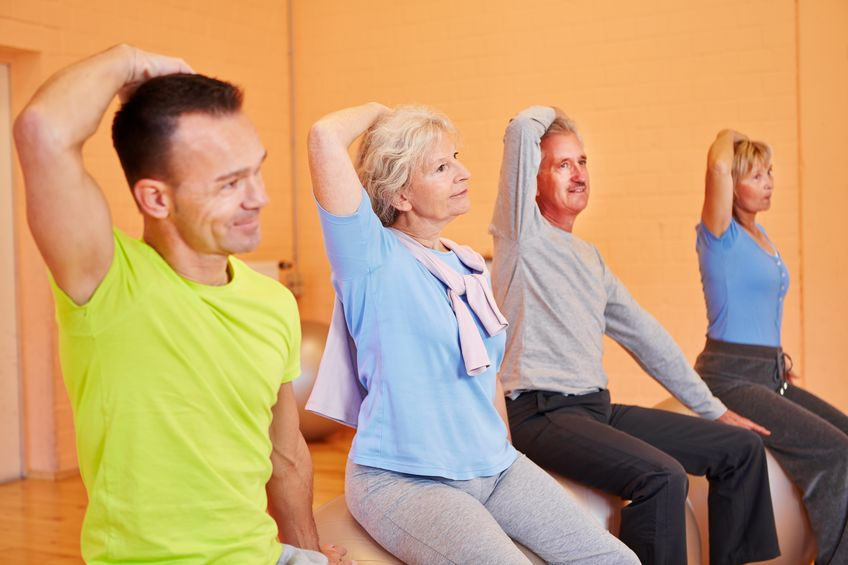 16490253 - group of senior people exercising in gym on fitness balls