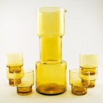 Funky barbell shaped carafe and six double shot glasses.