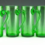 Tall hand-blown bar glass mugs in grass green.