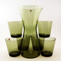 This set is a new production of an ever-popular late 1950's design called Kartio. Reproduced in this color (moss green) by Iittala, Finland in 2009.