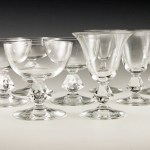 Vintage cut crystal stemware set with cut rohmbus shaped stems. The 4-sided stem is solid crystal with sharp edges. The uneven square causes a prism effect.