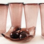 Tall tapered tumblers and nut dish made of hand blown glass with bejillions of intentional interior bubbles.