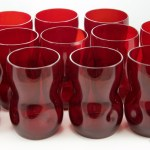 Vintage tumbler set of 12 hand blown glass retro modern pinched tumblers in ruby red. Rare to find as a large set.