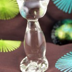 Mid-century modern stylized crystal cat figurine in colorless glass. Made in the 1960's by Rainbow Art Glass, USA.