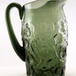 Hand-formed mid-century vintage glass pitcher in smoke green with ice lip. This is a stunning beverage pitcher. In the late 1950's to early 1960's, smoked colors were very popular