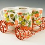 Sweet set of 4 retro flower garden mugs with orange wagon caddy.