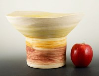 The Haeger spittoon vase is mission style decor on natural unglazed pottery. The shape is organic free-form design.