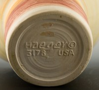The Haeger spittoon vase is signed on bottom in Haeger's mid-20th century font 'Haeger 3178 USA'.