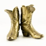 air of well-worn cowboy boots in solid brass.