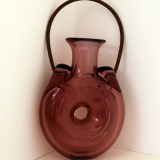 Forato hand blown flask with aged metal handle in amethyst glass.