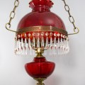 This Victorian style hanging lamp was made in the late 1970's by Fenton Art Glass, USA. It is a reproduction of authentic Victorian lamps, and made with modern materials.