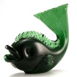 Glass artists from mid-century Italy produced a wide range of stylish fish figurines.Many Italian glass makers produced fish with big lips, but artists like Seguso and Tosoare usually credited for the early stylized form.