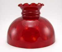 The beautiful ruby glass shade was made by hand, blown from an optic mold. The color is deep red with accents of yellow. The glass globe at the bottom was blown from a vertical optic mold and is pure ruby, no yellow accents.