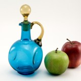 Large hand-blown vintage glass cruet in canary yellow and blue.