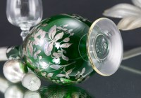 Hand-blown emerald glass with applied disc foot.