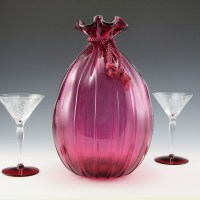 Beautiful, hefty vintage cranberry glass vase in the shape of a bag, with original silk rope tie. Pre-1970 production.
