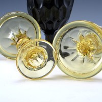 This set was made with a 2-part mold. They could be early pressed glass, circa 1920's - 1930's.