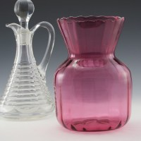 This vase has a deep, rich cranberry color with fairly thin blown optic glass.
