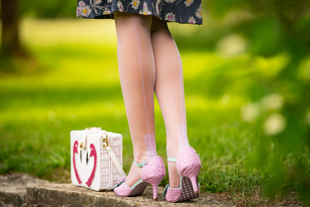 RetroCat wearing lilac nylons and matching sandals