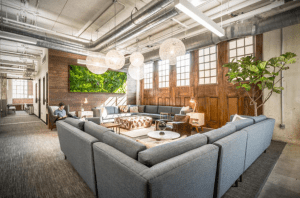36°N offers a co-working membership, which allows people to come in and co-work anywhere within the space, including in a living room, lounge area, and at tables and chairs spread out in other rooms.