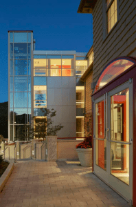 Croxton Collaborative Architects was able to significantly increase the amount of usable interior square footage from 12,000 to 21,000 square feet without expanding the building's historic perimeter walls. The team carved habitable space out of the basement and the attic, which now is the most architecturally dramatic space. Massive skylights and a wall of new glass fill the attic with light.