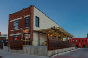 In Des Moines, Iowa, patrons can enjoy fine wine in beautifully historic surroundings at Della Viti, a wine bar that has made its home in a repurposed 19th century row house.