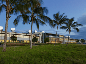 The National Oceanic and Atmospheric Administration's Inouye Regional Center, Pearl Harbor, Oahu, Hawaii, is a renovation of two WWII hangars. The glass section in the center is a new connector piece. The skin on the hangars had to be replaced because of asbestos and other contamination, but the new construction reflects the prior building conditions. PHOTO: Alan Karchmer
