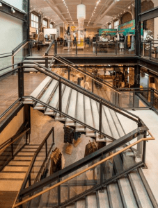 As part of the YMCA, the Bedford Building had two stacked gymnasiums on the northeast side, which offered open floor plates. By removing the gymnasiums' 4-story south masonry bearing wall, a monumental stair and skylight connects all floors and fills whimsical retailer Anthropologie with daylight.