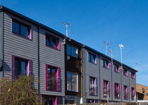 AFTER: Prefabricated wall panels installed on an existing multifamily building were designed to make the building energy-efficient, warm and desirable to tenants.
