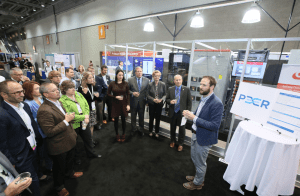 PEER program leaders discuss certification and efforts being made to create more resilient, reliable and sustainable power systems in front of an onsite microgrid at Greenbuild 2017. PHOTO: U.S. Green Building Council