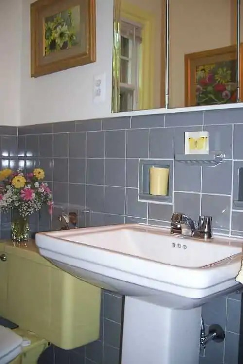 roberta's gray and yellow bathroom fixit - world of tile to the