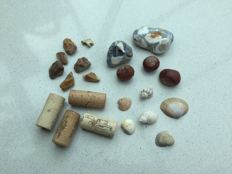 Picture of everyday items like stones gravel shells conkers and corks which can be used to put in your self-worth jar every time you take an action that increases your self-worth