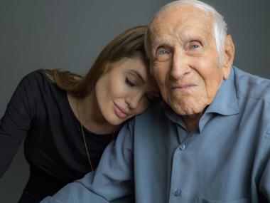 "Louis Zamperini with ""Unbroken"" producer Angelina Jolie"