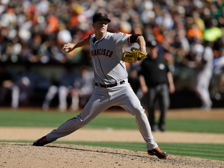 San Francisco Giants pitcher Matt Cain works against the Oakland Athletics in the sixth inning of a baseball game Saturday, Sept. 26, 2015, in Oakland, Calif.