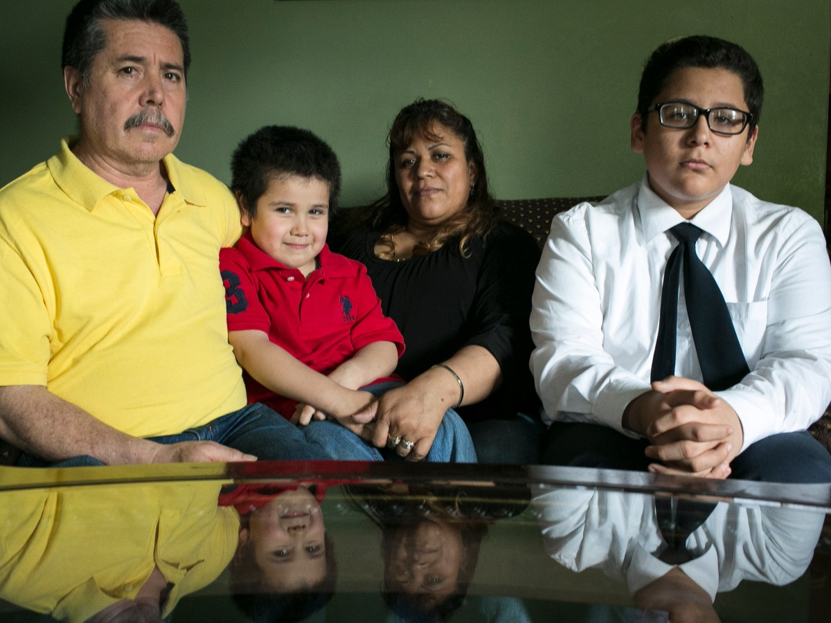 Alfonso and Patricia Cavada at their home in Archer Heights with their sons Michael, 5 and Alfonso Jr., 14.